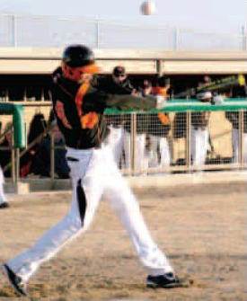 Gravette's Ethan Vanderpool pops one up foul in play on March 5 at Gravette's new baseball stadium.