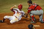 Mississippi Valley State's catcher German Hays tags out Arkansas Razorbacks' Brian Anderson at home in the seventh inning Wednesday night at Dickey-Stephens Park in North Little Rock.
