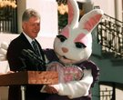 President Bill Clinton poses with a rather frisky Easter Bunny on April 13, 1998, at the White House