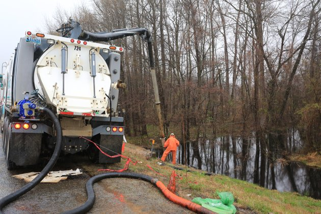 workers-continue-to-siphon-crude-oil-from-a-creek-along-a-frontage-road-on-the-east-side-of-interstate-40-in-mayflower-saturday-after-a-pipeline-rupture-friday-in-the-northwood-subdivision-in-mayflower