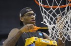 Wichita State forward Carl Hall celebrates by cutting down the net after defeating Ohio State 70-66 in a West Regional final in the NCAA college basketball tournament, Saturday, March 30, 2013, in Los Angeles. (AP Photo/Mark J. Terrill)