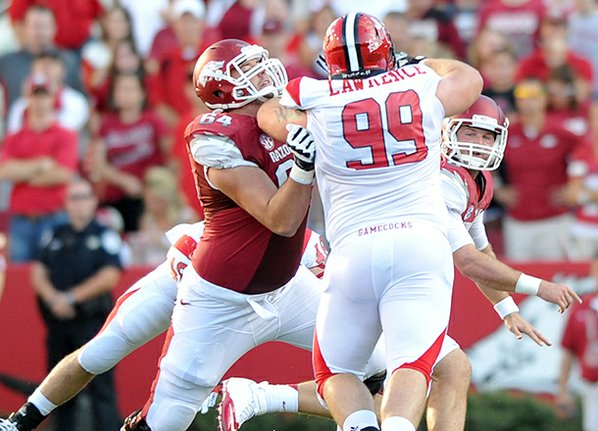 Arkansas center Travis Swanson puts ...