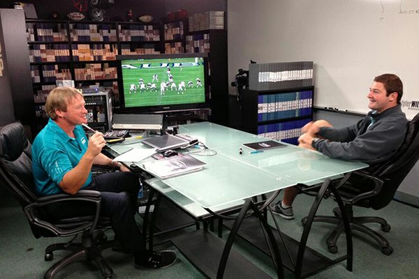 Former Arkansas quarterback Tyler Wilson (right) talks with ESPN 'Monday Night Football' announcer Jon Gruden.