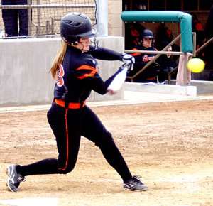 Gravette's lead-off batter, Meagan Ward, knocks one over the fence in the Lady Lions' first at-bat against Ozark on Monday.
