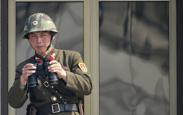 a-north-korean-soldier-watches-the-south-korean-side-at-the-border-village-of-panmunjom-in-the-demilitarized-zone-dmz-in-south-korea-thursday-april-4-2013-south-koreas-defense-minister-said-thursday-north-korea-has-moved-a-missile-with-considerable-range-to-its-east-coast-but-said-it-is-not-capable-of-hitting-the-united-states