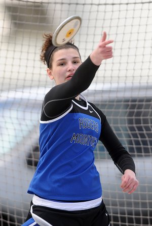Tori Metheny of Rogers High School throws a discus Thursday, April 4, 2013, at Glenn W. Black Stadium in Siloam Springs during the Panther Relays.
