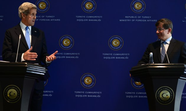 us-secretary-of-state-john-kerry-left-speaks-during-a-news-conference-with-his-turkish-counterpart-ahmet-davutoglu-unseen-in-istanbul-turkey-sunday-april-7-2013-kerry-is-in-the-middle-east-his-third-trip-to-the-region-in-two-weeks-in-a-fresh-bid-to-unlock-long-stalled-israeli-palestinian-peace-talks