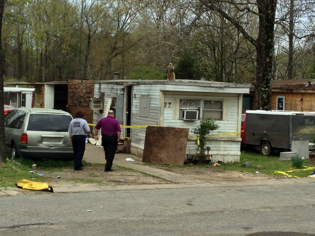 crime-scene-investigators-work-the-scene-monday-april-8-2013-where-a-man-was-shot-multiple-times-at-8510-scott-hamilton-drive-and-later-died