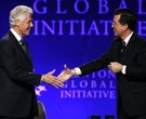 Former President Bill Clinton and Comedy Central's Stephen Colbert, right, shake hands before an int
