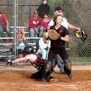 After a play at home plate, Gentry catcher Shannea Smartt looks to second, ready to throw, in play against Lincoln on Friday.