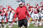 Arkansas offensive coordinator Jim Chaney watches practice at Razorback Stadium in Fayetteville.
