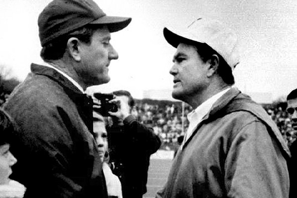 Arkansas football coach Frank Broyles, left, and Texas coach Darrell Royal greet on the field in Fayetteville, Ark., in this Dec. 6, 1969, file photo. No. 1 Texas defeated no. 2 Arkansas 15-14. (AP Photo/Arkansas Democrat-Gazette, File)