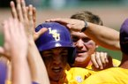 LSU's Alex Bregman is congratulated by teammates after hitting a two-run home run in the top of the third inning against Arkansas on Sunday, April 14, 2013, at Baum Stadium in Fayetteville.