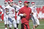 Arkansas receivers coach Michael Smith works with his team during practice Saturday morning at Razorback Stadium in Fayetteville.