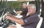 Former Arkansas Athletic Director Frank Broyles (left) and Pat Summerall prepare to head out for the start of the 2008 Pat Summerall Celebrity Classic at Chenal Country Club in Little Rock.