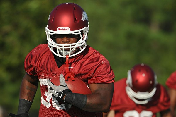 Arkansas captain Kiero Small and the rest of the Razorbacks' football team returned to the practice field Sunday after a day off.