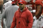 Arkansas Assistant Coach Joel Thomas works with the Razorbacks during practice on Saturday, March 30, 2013 in Fayetteville.