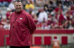 Arkansas coach Bret Bielema watches his team warm up before the 2013 spring game at Donald W. Reynolds Razorback Stadium.