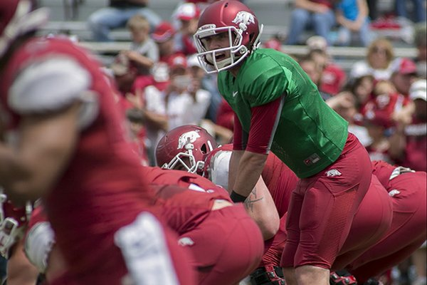 Arkansas Red Team quarterback Brandon Allen calls a play at the line of scrimmage during the first half of a spring NCAA college football game in Fayetteville, Ark., Saturday, April 20, 2013. Arkansas Red beat Arkansas White 34-27. (AP Photo/Gareth Patterson)