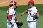 Arkansas catcher Jake Wise congratulates pitcher Colby Suggs after he picked up the save in Arkansas' 2-1 win over Texas A&M Sunday afternoon at Baum Stadium in Fayetteville.