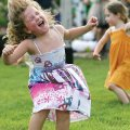 Abella Martin of Fayetteville dances during a concert by the children's band Milkshake during a free...