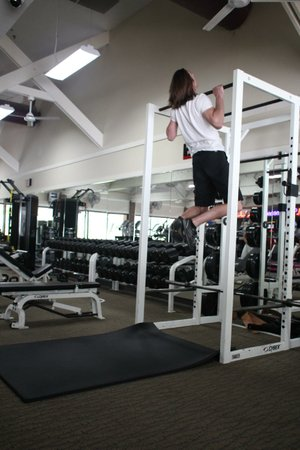 Paul Fajer, a personal trainer at Little Rock Athletic Club, had no problem whatsoever doing the Burpee Pull-up, but exercisers who lack his strength, height and experience can modify the exercise by replacing the pull-ups with a leap to touch the bar.