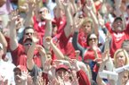 University of Arkansas Razorback fans call the hogs as they prepare for the start of Saturday's Red White Scrimmage at Razorback Stadium in Fayetteville.