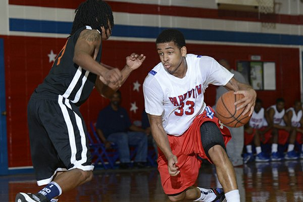 Parkview's Anton Beard (33) drives past Hall's Javon Perry during a 2013 game in Little Rock.