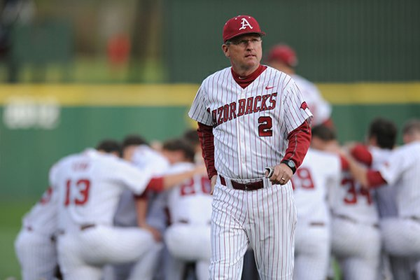 Arkansas coach Dave Van Horn walks to the dugout Saturday, April 20, 2013, before the start of play against Texas A&M at Baum Stadium in Fayetteville.