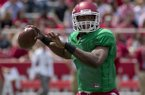 Arkansas quarterback Brandon Mitchell throws a pass during the first half of a spring NCAA college football game in Fayetteville, Ark., Saturday, April 20, 2013. (AP Photo/Gareth Patterson)