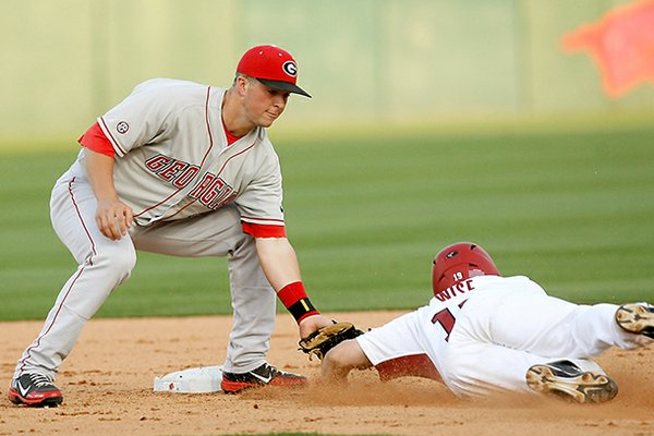 Arkansas' Jake Wise is tagged out by Georgia shortstop Kyle Farmer at second at Baum Stadium in Fayetteville on Friday, April 6, 2012.