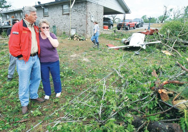 gov-mike-beebe-comforts-homeowner-lou-baker-following-a-killer-tornado-that-struck-the-vilonia-area-on-april-25-2011-the-twister-claimed-five-lives-destroyed-several-homes-and-marred-much-of-the-landscape-in-its-path-now-two-years-later-both-physical-and-emotional-signs-of-the-storm-still-remain