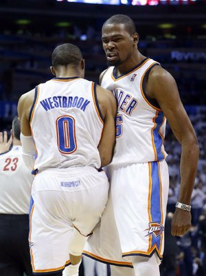 Kevin Durant (right) and teammate Russell Westbrook each scored 29 points to lead the Oklahoma City Thunder to a 105-102 victory over the Houston Rockets on Wednesday night.