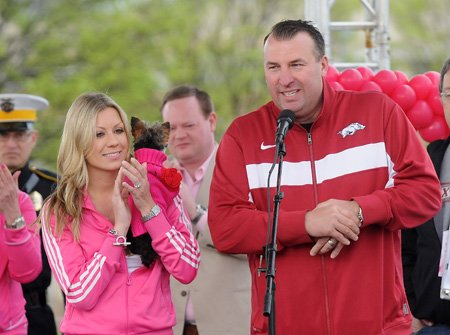 Bret Bielema, Arkansas head football coach, right, and wife, Jen, welcome attendees to the Race for the Cure.