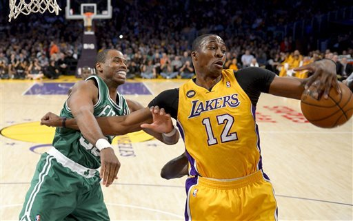 boston-celtics-center-jason-collins-left-battles-los-angeles-lakers-center-dwight-howard-12-for-a-rebound-during-the-first-half-of-their-nba-basketball-game-wednesday-feb-20-2013-in-los-angeles-nba-veteran-center-collins-has-become-the-first-male-professional-athlete-in-the-major-four-american-sports-leagues-to-come-out-as-gay-collins-wrote-a-first-person-account-posted-monday-april-29-2013-on-sports-illustrateds-website