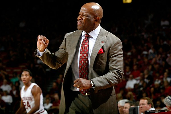 Arkansas head coach Mike Anderson signals to his players during the second half against Texas A&M on Saturday, March 9, 2013, at Bud Walton Arena in Fayetteville.