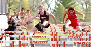 Gentry junior Jerod Cousins leads his heat in the 110 meter hurdles at the district track meet held in Gravette on Thursday.