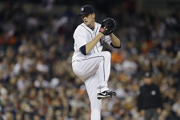 Detroit Tigers relief pitcher Drew Smyly throws during the eighth inning of a baseball game against the Minnesota Twins in Detroit, Tuesday, April 30, 2013. (AP Photo/Carlos Osorio)
