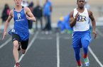 North Little Rock's Kavin Alexander (right) won the boys 100 meters in a time of 10.56 seconds Thursday at the Class 7A track and field meet in Benton. Chase Lamers (left) of Rogers was third in 10.83.