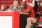 Arkansas athletics director Jeff Long, left, talks with Arkansas head basketball coach Mike Anderson during the Red/White scrimmage Tuesday, Oct. 30, 2012, at Bud Walton Arena in Fayetteville.