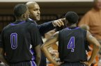 Central Arkansas head coach Corliss Williamson talks to guard Robert Crawford (0) and guard Lenell Brown (4) during the first half of an NCAA college basketball against Oklahoma State game in Stillwater, Okla., Sunday, Dec. 16, 2012. (AP Photo/Sue Ogrocki)
