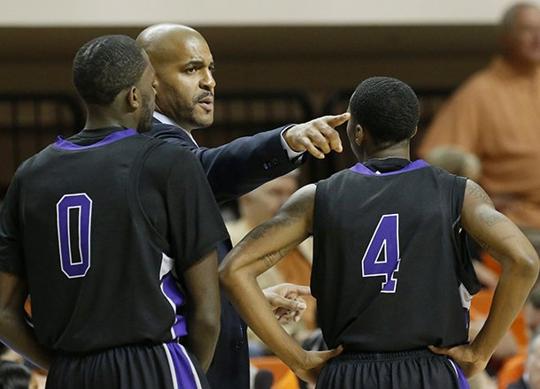 central-arkansas-head-coach-corliss-williamson-talks-to-guard-robert-crawford-0-and-guard-lenell-brown-4-during-the-first-half-of-an-ncaa-college-basketball-against-oklahoma-state-game-in-stillwater-okla-sunday-dec-16-2012-ap-photosue-ogrocki