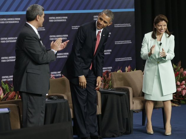 us-president-barack-obama-center-is-introduced-at-a-forum-on-inclusive-economic-growth-and-development-at-the-old-custom-house-in-san-jose-costa-rica-saturday-may-4-2013-on-stage-with-obama-are-incae-university-president-arturo-condo-left-and-costa-ricas-president-laura-chinchilla-right