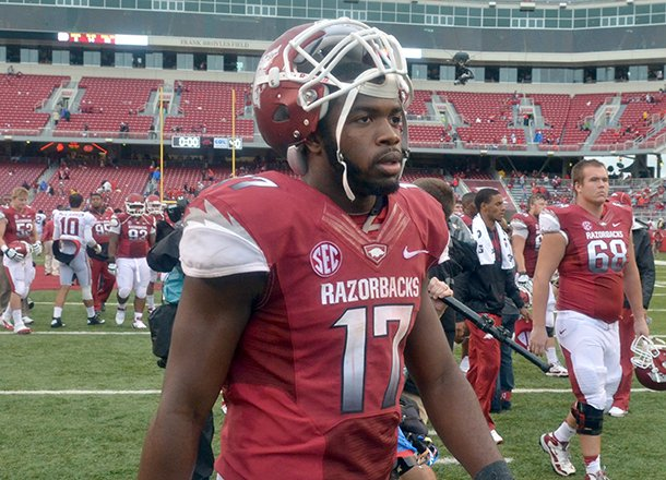 arkansas-quarterback-brandon-mitchell-walks-off-the-field-following-the-razorbacks-52-0-loss-to-alabama-on-sept-15-2012-at-razorback-stadium-in-fayetteville