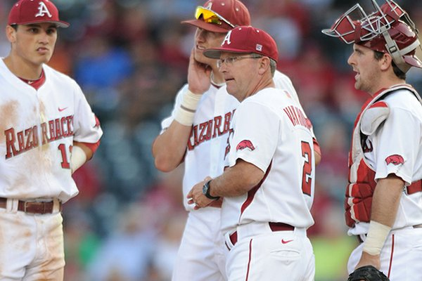 Arkansas coach Dave Van Horn makes a pitching change Tuesday, April 30, 2013, during the fourth inning of play against Missouri State at Baum Stadium in Fayetteville.
