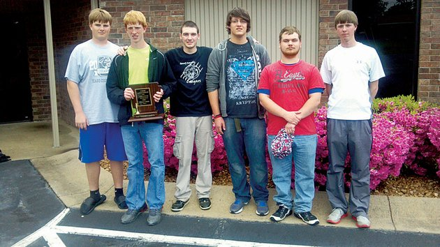 from-the-left-eric-vest-andrew-walker-marcus-mccormick-cary-behm-chandler-holt-and-coach-steven-walker-pose-with-the-trophy-the-team-received-for-winning-the-class-1a2a-state-chess-championship-in-beebe-on-april-27-this-is-the-teams-first-state-title-since-2008