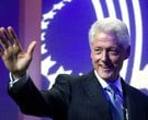 Former U.S. President Bill Clinton waves to the audience as he opens the Clinton Global Initiative,