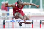 Arkansas hurdler Caleb Cross clears a hurdle in the 100 meter hurdles on April 27, 2013 during the Arkansas Team Invitational at John McDonnell Field in Fayetteville.