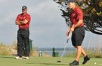 Arkansas coach Brad McMakin (left) believes his team will win the NCAA Regional at the Blessings golf course in Fayetteville.