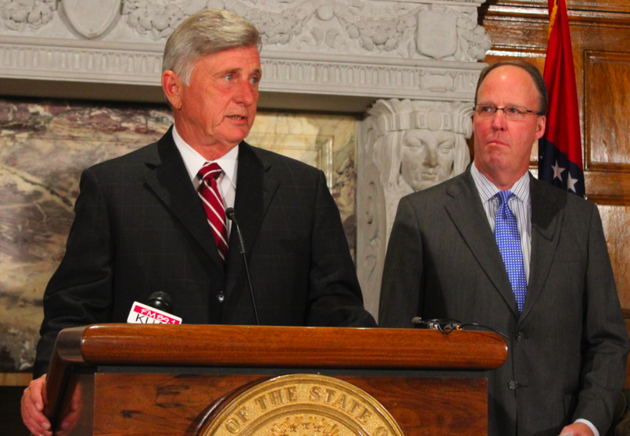 gov-mike-beebe-speaks-while-midcontinent-independent-system-operator-president-and-ceo-john-bear-looks-on-wednesday-at-the-state-capitol